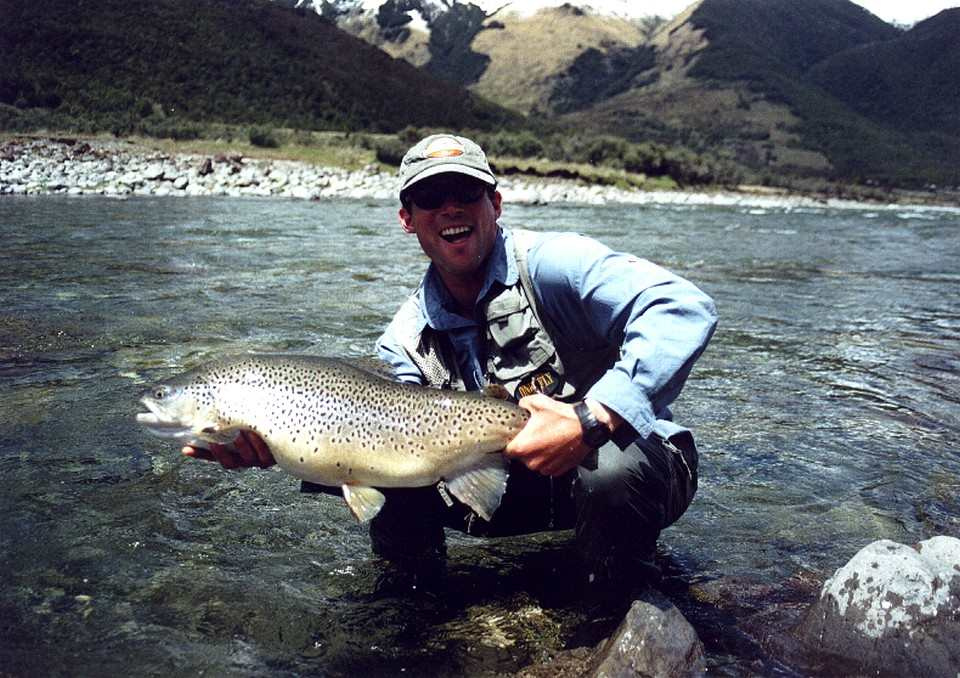 Guide John Gendall with a fine New Zealand trout of 16lbs